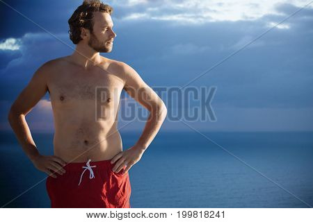 Men in summer  against scenic view of seascape against cloudy sky