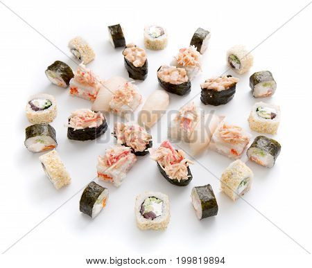 Sushi assortment isolated on white background. Big set of seafood rolls, spicy gunkans and various fish nigiri. Japanese food delivery