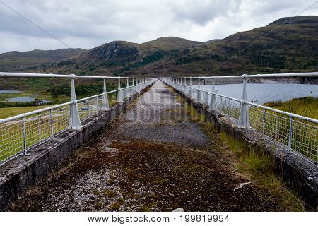 Walking Path On Top Of Hydroelectric Dam Wall In Scotland