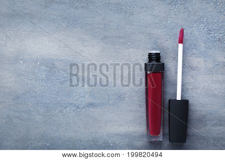 Colorful Lip Gloss On Grey Wooden Table