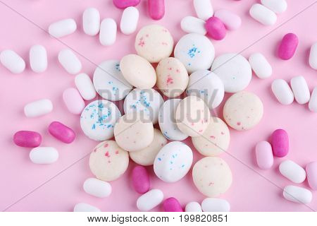Different chewing gums on the pink background