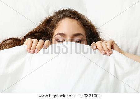 Young woman sleeping in the white bed