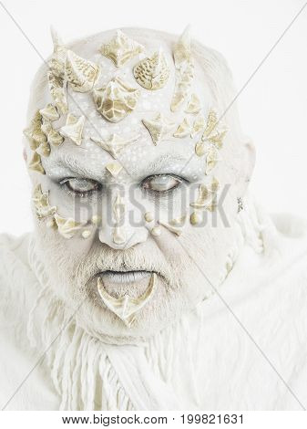 Reptilian Man With Blind Eyes And Beard On Thorny Skin