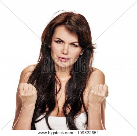 Unhappy sad woman showing fists after fail