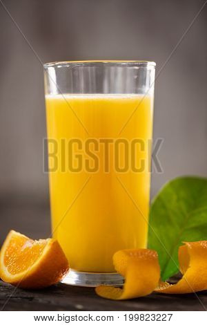 orange juice with orange slices on wooden table background