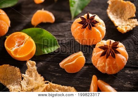 Fresh and juicy tangerine fruits on the rustic table
