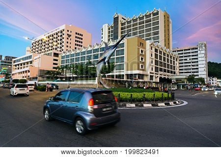 Kota Kinabalu, Malaysia - August 01, 2017: Car At The Roundabout In Kota Kinabalu City During Sunset