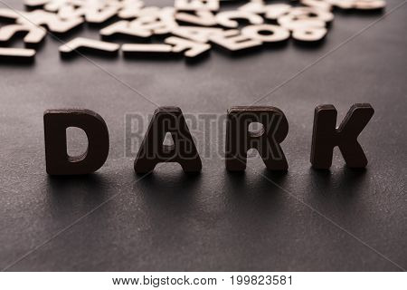 Word Dark standing on table background. Night, obscurity concept