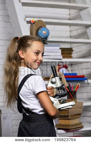 Kid And School Supplies On Classroom Background, Defocused