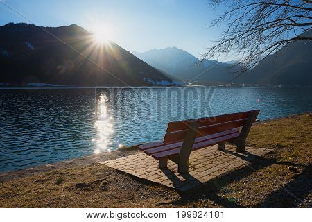 peaceful place with bench for enjoying sunset at achensee lakeside austria
