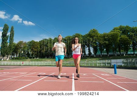 Runner Man And Woman Running On Arena Track
