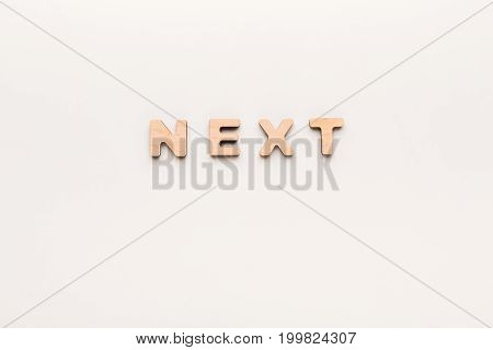 Word Next on white background. Continued, success, challenge concept