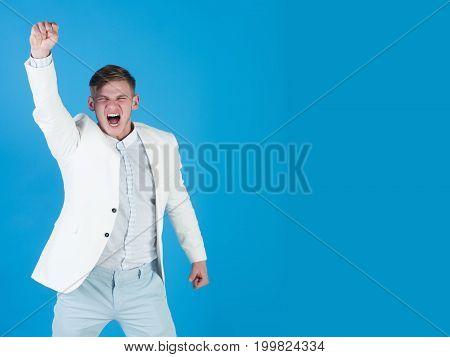 Businessman Celebrating Achievement On Blue Background