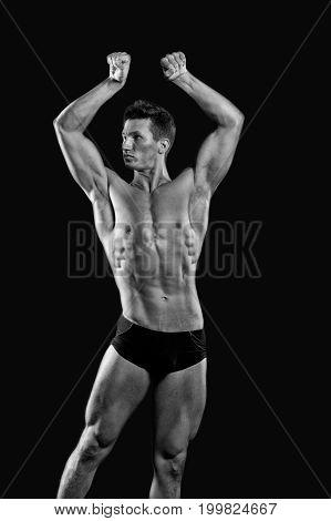 Athletic Bodybuilder Pose In Pants.