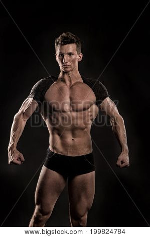 Man With Muscular Body Of Bodybuilder In Pants