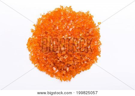 Orange Citrine gemstones pile on white background, top view. Bright backdrop of natural jewels with free space for text, close up.