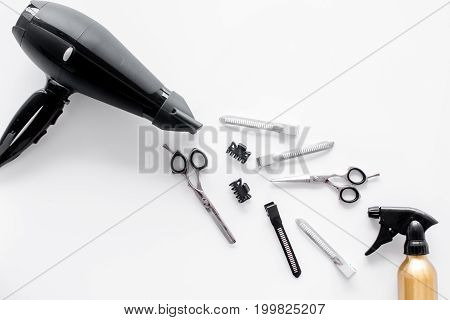 Hairdryer and hairdresser tools in beauty salon on white background top view.