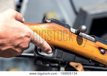 Finger on the trigger of the old rifle
