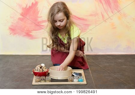 Girl In Cook Apron With Cookies