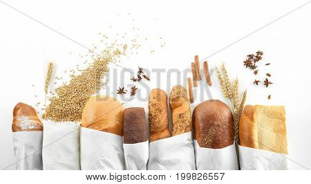 Composition of freshly baked delicious bread wheat and salt on the wooden table copyspace countryside kitchen bakery concept.