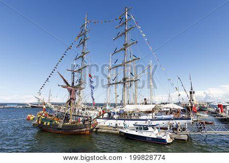 TALLINN ESTONIA - JULY 18 2017: Sailing ships in harbor during Maritime Days in Tallinn Estonia on July 18 2017