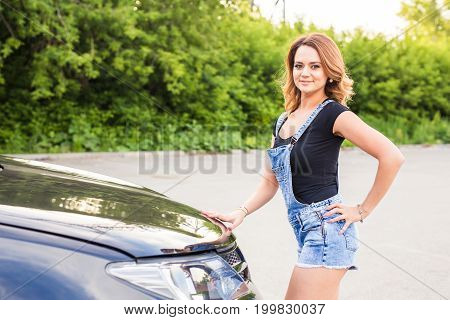 Broken car, accident and people concept - Woman open the car hood and broken automobile on the side.