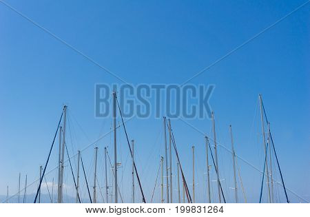 Close-up of some Sail Masts in front of a clear Sky. View on many Sail Masts.