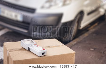 Parcel with barcode scanner and white van