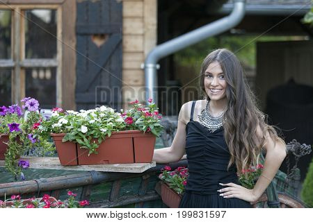 Young Beautiful Woman In Dress Standing In The Park