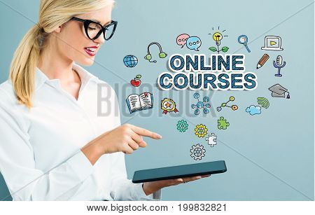 Online Courses text with business woman using a tablet