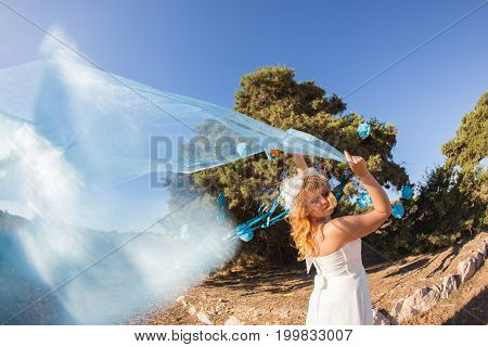 newly married couple.wind lifting long white bridal veil