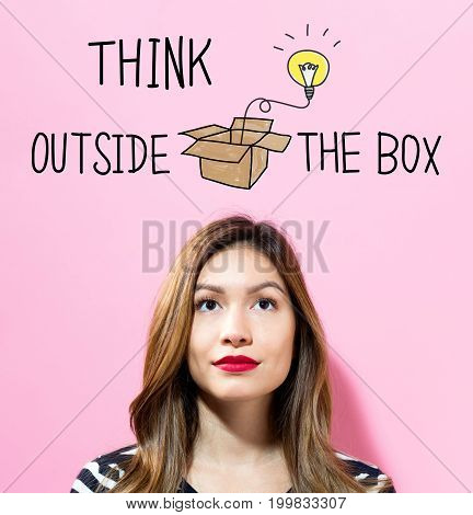 Think Outside The Box text with young woman on a pink background