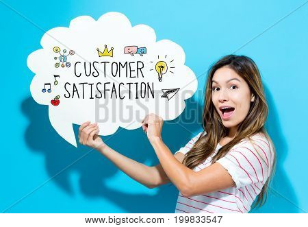 Customer Satisfaction text with young woman holding a speech bubble on a blue background