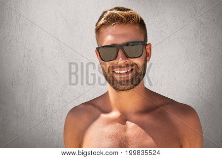 Handsome Tanned Man With Trendy Hairdo, Bristle, Standing Topless, Demonstrating His Muscular Body,