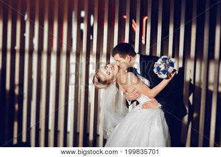 Stylish Couple In Love The Bride And Groom Are Dancing, Kissing And Cuddling In The Modern And Styli