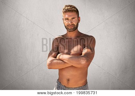 Topless Handsome Macho Man With Crossed Hands, Feeling His Strenght And Confidence Posing At Camera.