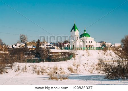 Gomel, Belarus. Church Of St Nicholas The Wonderworker And Frozen Sozh River In Sunny Winter Day. Orthodox Church Of St. Nikolay Chudotvorets