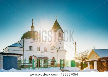 Gomel, Belarus. Sun Shining Over Church Of St Nicholas The Wonderworker In Sunny Winter Day. Orthodox Church Of St. Nikolay Chudotvorets At Sunset Or Sunrise.