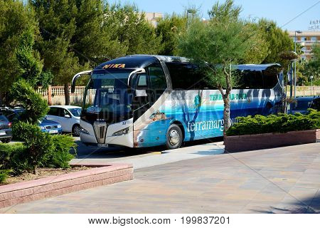 SALOU SPAIN - MAY 25: The modern bus for tourists transportation is near entrance to hotel on May 25 2015 in Salou Spain. Up to 60 mln tourists is expected to visit Spain in year 2015.