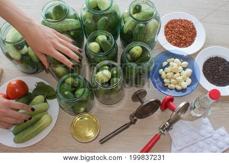 gurtsov conservation. Fresh cucumbers in jars. Process of cucumber conservation
