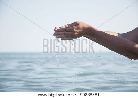 Handful of clear blue water