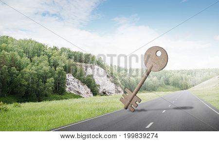 Key stone figure as symbol of access outdoor against natural landscape