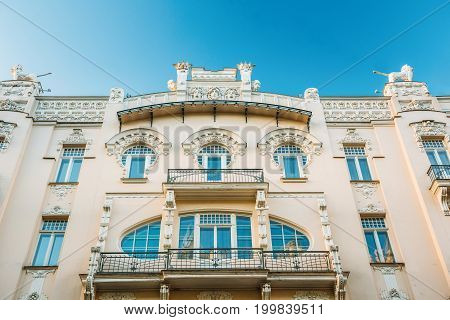 Riga, Latvia. Facade Of Old Art Nouveau Building designed by Mikhail Eisenstein on 4 Alberta Street. Sunny Summer Day Under Blue Clear Sky. UNESCO World Heritage Site