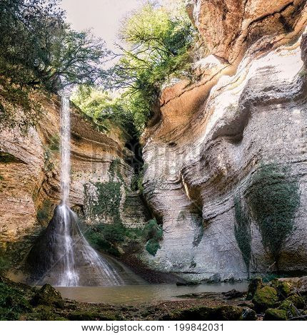 Large waterfalls in green tropical forest at Abkhazia. Selective focus on waterfall.