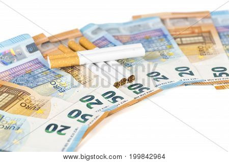 20 and 50 Euro banknotes bills cash with cigarettes with cigarettes box. Concept of cost of tabacco cigarettes. Front and top view close-up. On white background