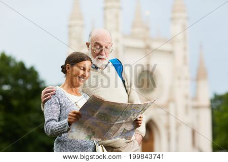 Traveling seniors looking for route in the foreign city during their journey