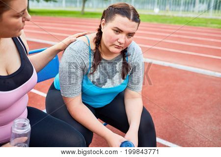 Young woman encouraging her friend after workout