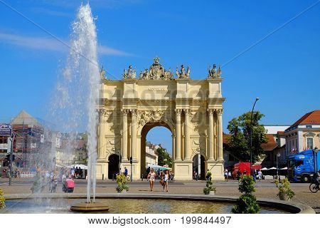 POTSDAM GERMANY - AUGUST 15 2017: View on the Brandenburg Gateand fountain in Potsdam.
