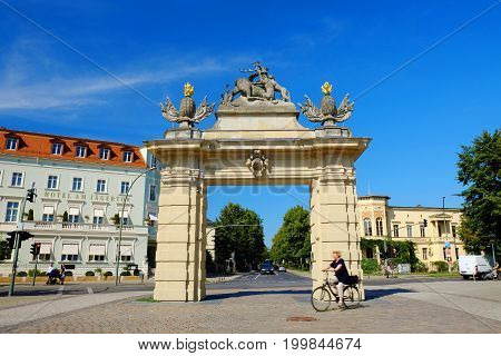 POTSDAM GERMANY - AUGUST 15 2017: View on the Jagertor and an unknown tourist in Potsdam.