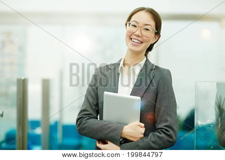 Happy young business leader with tablet
